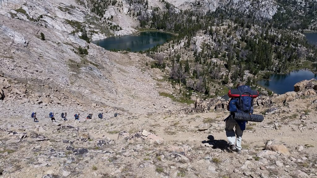 Part of our group descending Windy Devil in the White Cloud Mountains. Headwall Lake and Scoop Lake can be seen in the background.