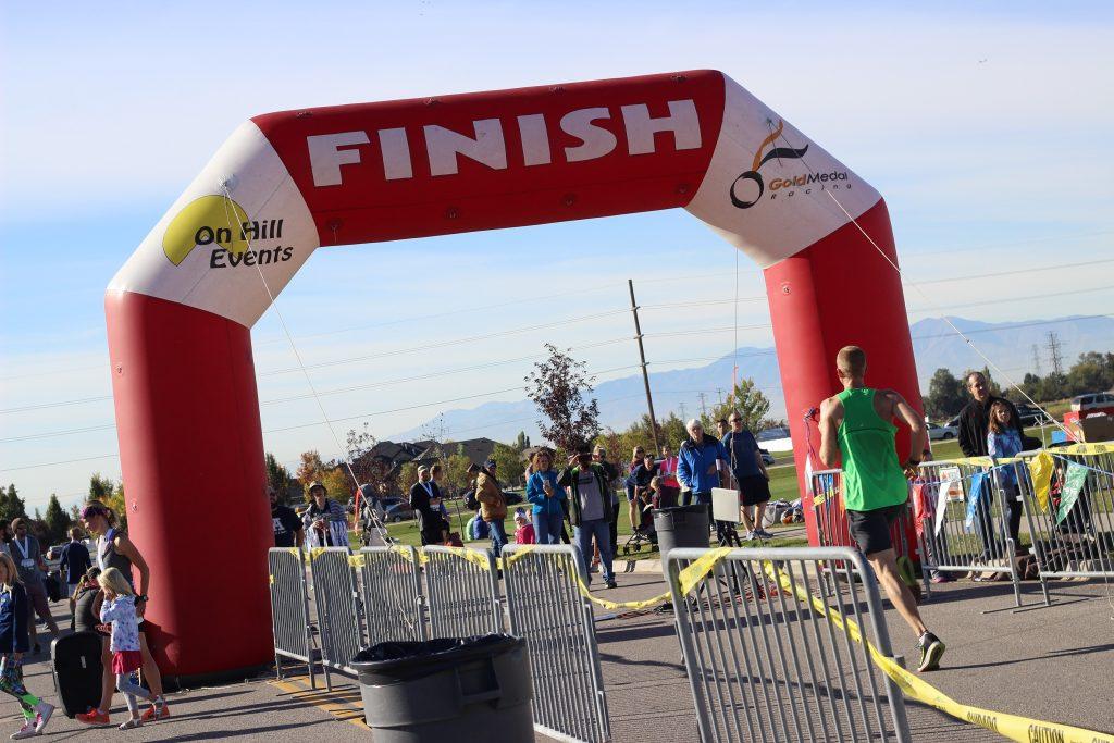 Crossing the finish line of the Layton Marathon