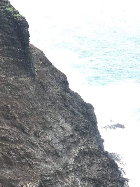 Hikers on Crawlers Ledge on the Kalalau Trail